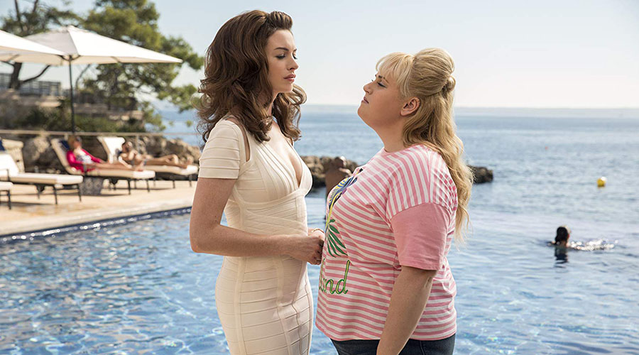 Watch the first trailer for The Hustle starring Anne Hathaway and Rebel Wilson!