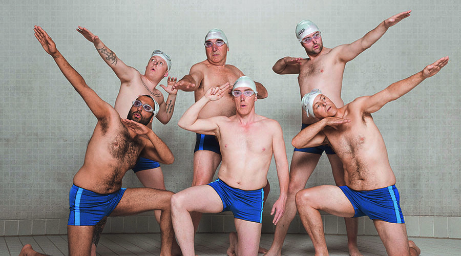 Swimming with Men is a 2018 British comedy film starring Rob Brydon, Jane Horrocks, Rupert Graves, Daniel Mays, Thomas Turgoose, Jim Carter, Adeel Akhtar and Charlotte Riley. It was directed by Oliver Parker. Inspired by the 2010 documentary, Men Who Swim, SWIMMING WITH MEN tells the story of Eric (Rob Brydon), an accountant in the throes of a mid-life crisis, who eventually finds new meaning to his life as part of an all-male, middle-aged amateur synchronised swimming team. The ramshackle squad slowly learn to reveal their inner lives, as well as their paunches and together they make a bid to compete at the Unofficial Male Synch-Swimming World Championships. With a talented British cast that includes Jane Horrocks (Absolutely Fabulous), Rupert Graves (TV's Sherlock) and Charlotte Riley (Peaky Blinders) SWIMMING WITH MEN is a delightful comedy that tips its (swimming) cap at beloved British films such as The Full Monty and Calendar Girls.