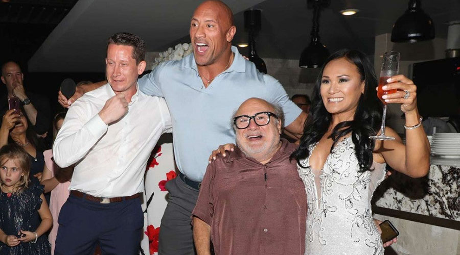 Watch Dwayne Johnson and Danny DeVito crash a wedding during their Jumanji: The Next Level press junket